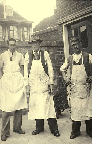 The original workshop owners: Charles Winlove and his two sons standing at the back of the building in the 1940s