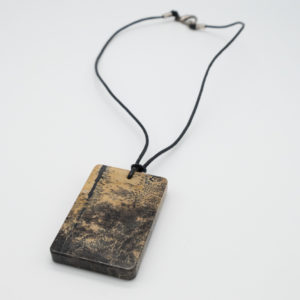 Linda McFarlane's landscape stone pendant is classic and understated necklace. The stone is cream and black in colour and sits at the end of a soft black rope necklace. It's a comfortable and stylish piece