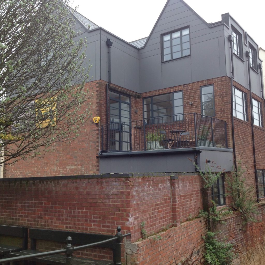 The building conversion: Rear view of the building over the River Purfleet