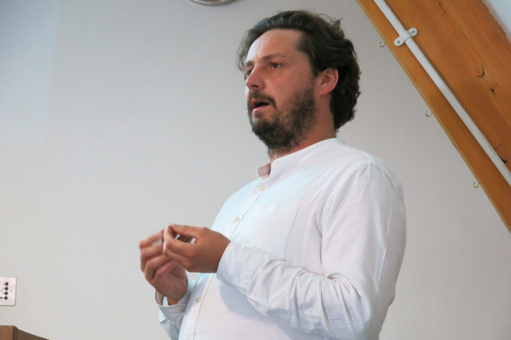 Adam Hogarth speaking at Fragile Nature symposium, 2019