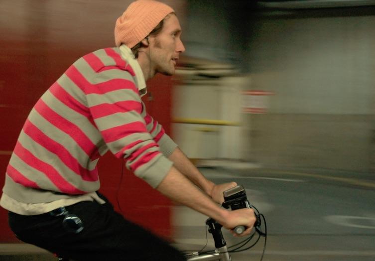 Rider Spoke man with striped shirt